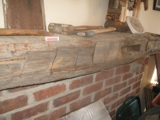 rustic mantle with ax markings